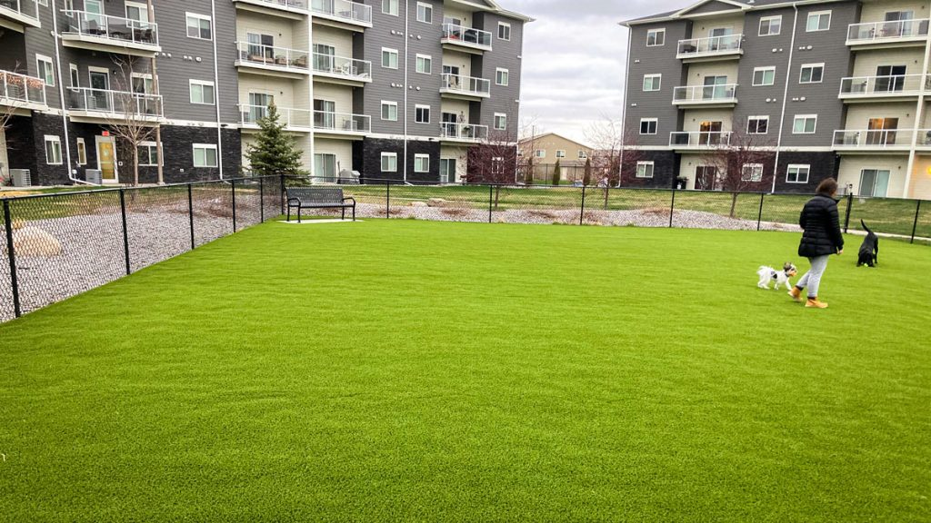 Greystone apartment residents enjoying landscaping project for outdoor recreational space.