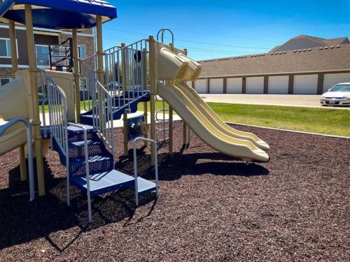Artisian Waukee playground and engineered wood surfacing - Front View