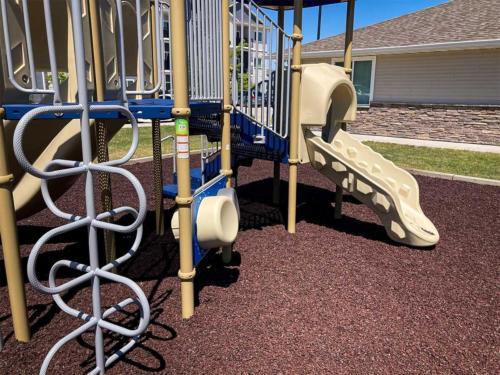 Artisian Waukee playground and engineered wood surfacing - Back View