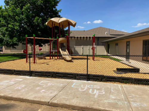 Playground and surfacing installation with chain link fence for Linwood Church - Front View.