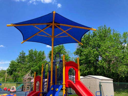 Top view of a commercial playground structure installed for Whistle Stop Academy.