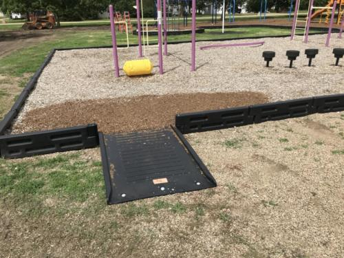 Flush mount ramp system for wheelchairs - Blunt Elementary